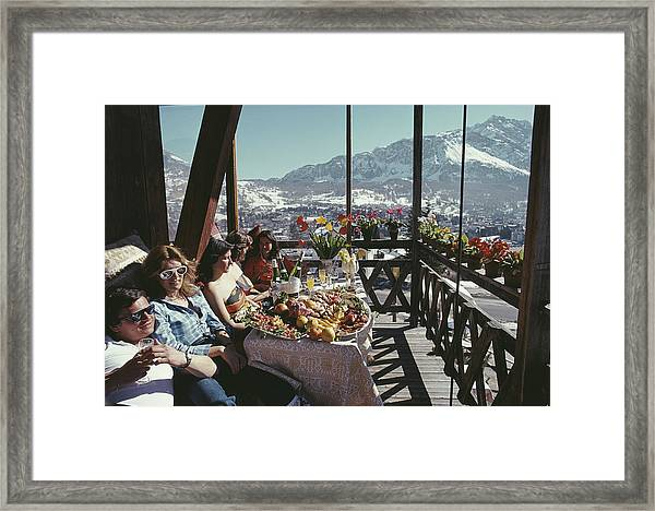 Catching The Sun In Cortina Framed Print by Slim Aarons
