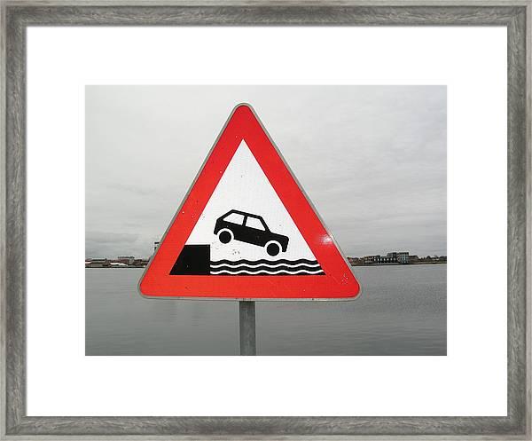 Caution Sign At Harbor Framed Print