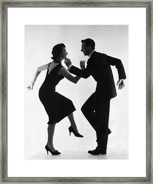 Cha-cha-cha Framed Print by Thurston Hopkins