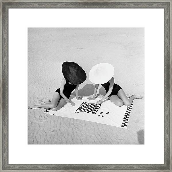Checkers On The Beach Framed Print