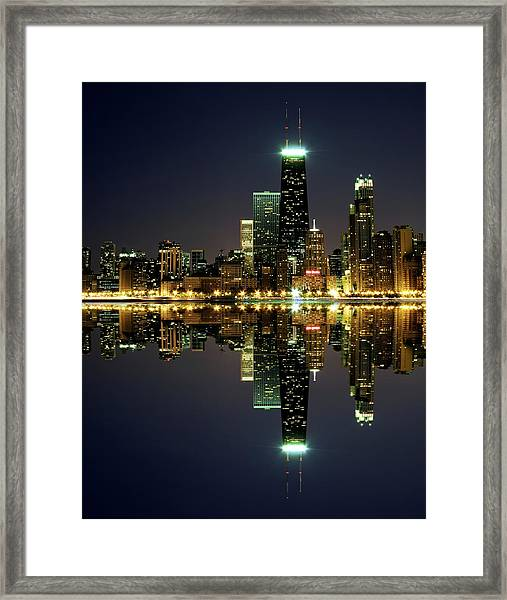 Chicago Skyline Reflected On Lake Framed Print by Pawel.gaul