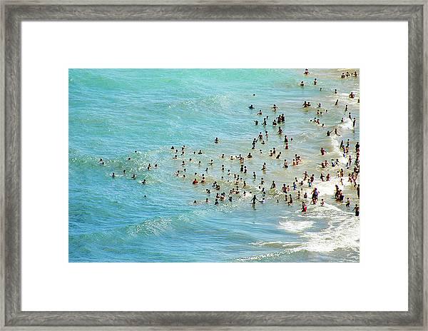Chicagos Oak St. Beach Framed Print by By Ken Ilio