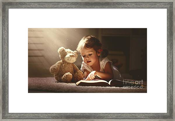Child Little Girl Reading A Magic Book Framed Print