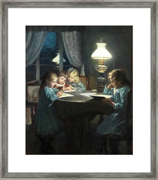 Children Reading By Lamp Light Framed Print