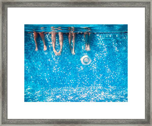 Childrens And Adults Legs Underwater In Framed Print by Kateryna Mostova