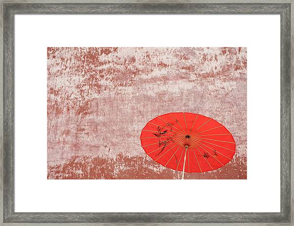 Chinese Parasol Against A Textured Wall Framed Print