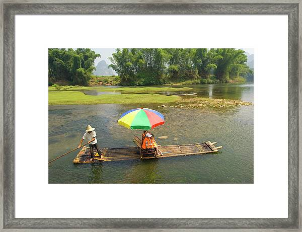 Chinese Tourists In Bamboo Raft At Framed Print