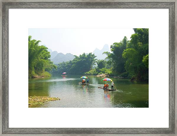 Chinese Tourists In Bamboo Rafts At Framed Print