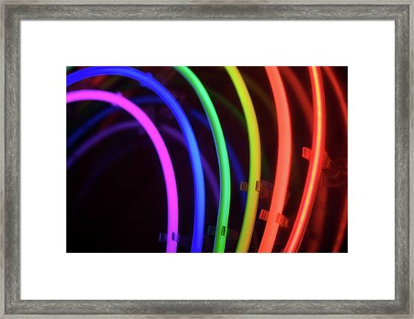 Circles Of Neon Rainbow Light Framed Print by Peskymonkey