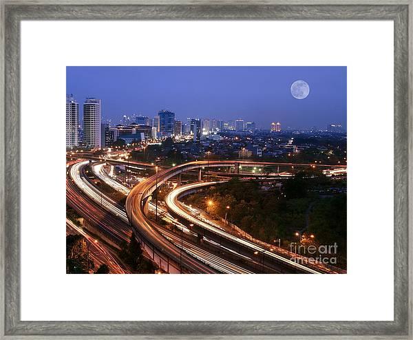 City Skyline With Multiple Flyovers Framed Print