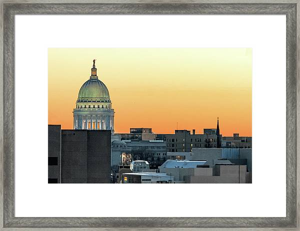 City Surrounds It Framed Print
