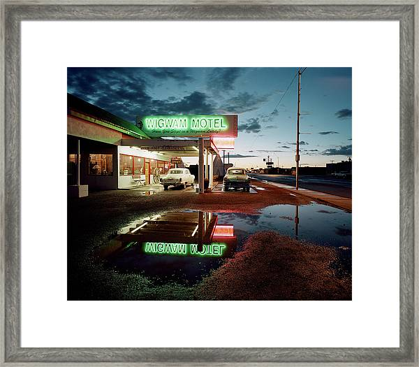 Classic Cars Parked By A Motel At Dusk Framed Print by Gary Yeowell