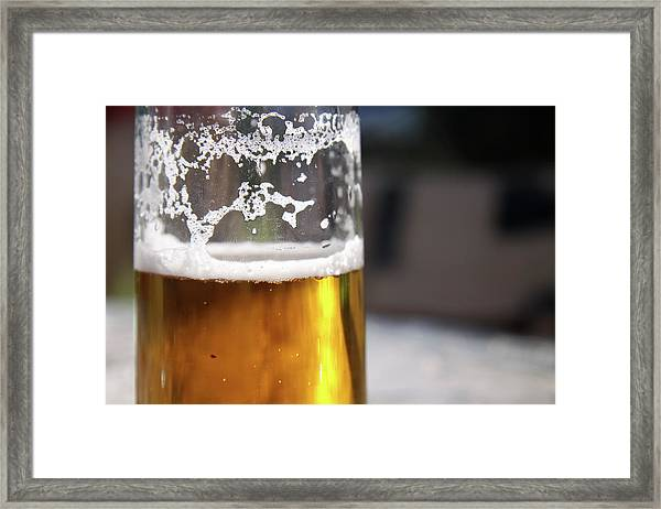 Close Up Of A Glass Of Lager Framed Print by Jodie Wallis