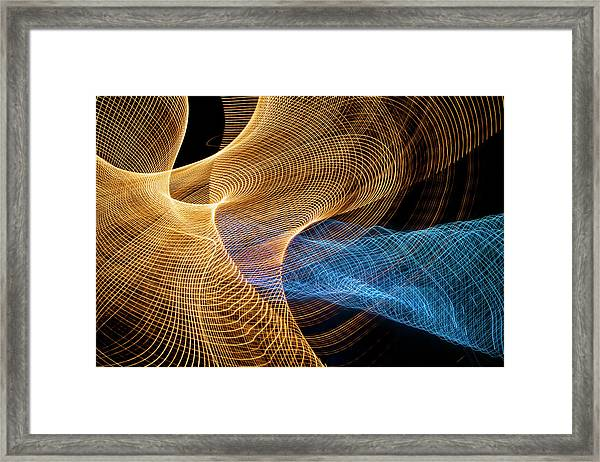 Close Up Of Flowing Light Trails Framed Print by John M Lund Photography Inc