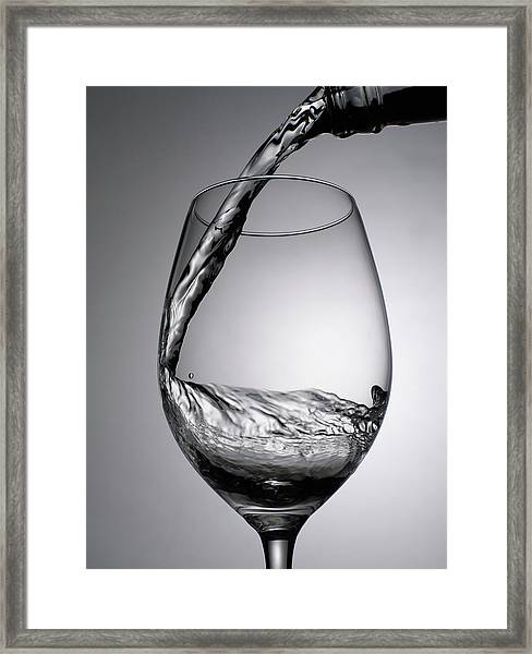 Close Up Of Wine Being Poured Into Wine Framed Print by Johner Images