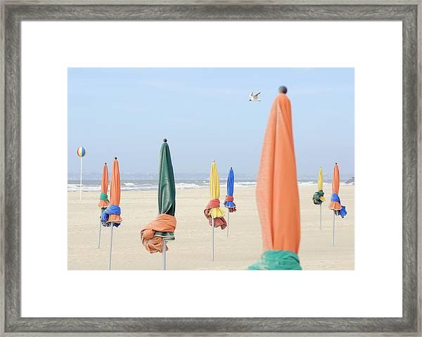 Closed Sunshades On Beach Framed Print