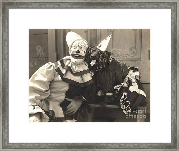 Clown Posing With Dog Dressed In Clown Framed Print