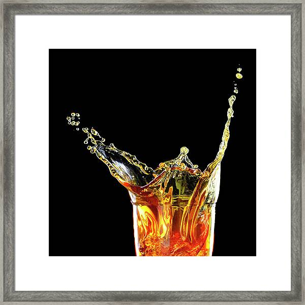 Cocktail With Big Splash In A Tumbler Framed Print by Chris Stein