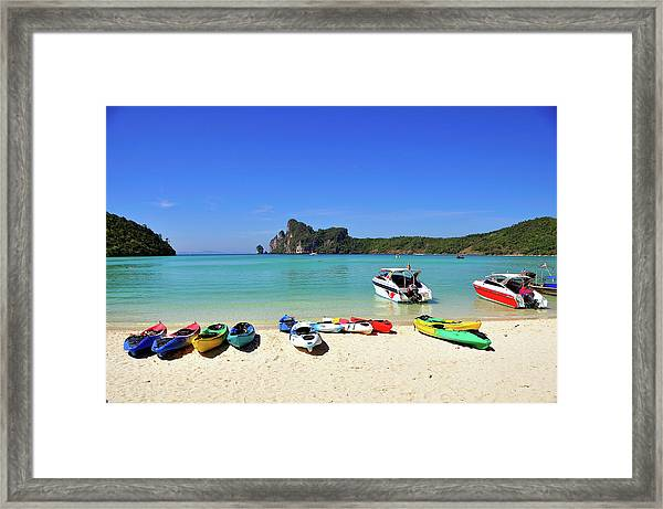 Colorful Canoes On Beach Framed Print