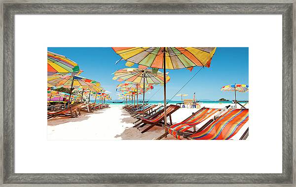 Colorful Sunshade And Chairs On Beach Framed Print