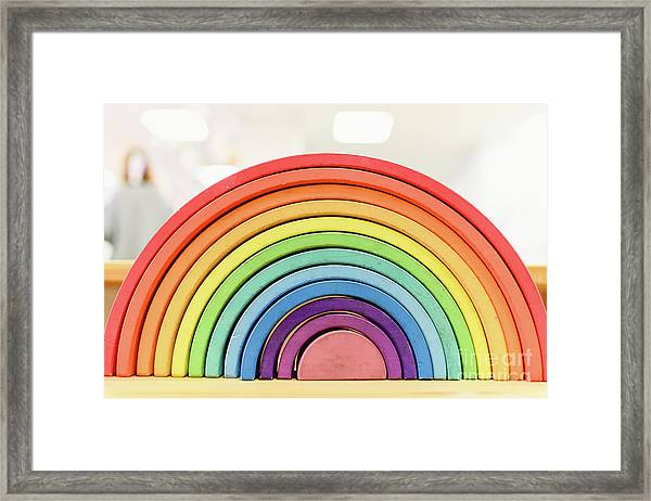 Colorful Waldorf Wooden Rainbow In A Montessori Teaching Pedagogy Classroom. Framed Print