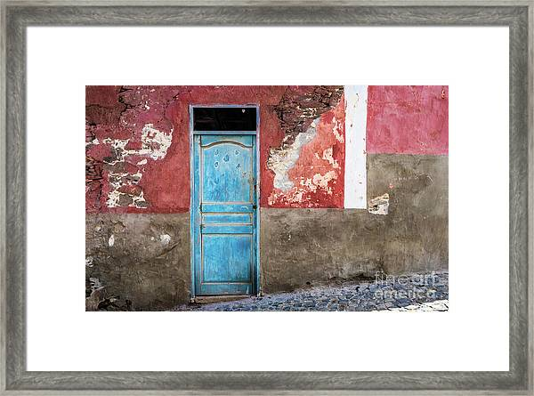Colorful Wall With Blue Door Framed Print