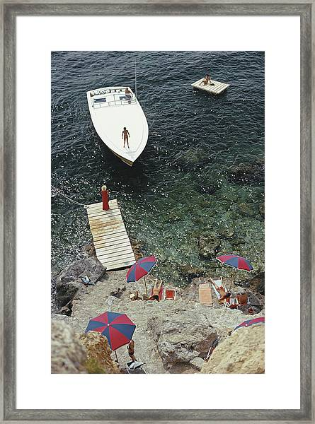 Coming Ashore Framed Print by Slim Aarons