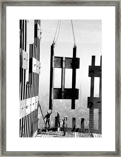 Construction Workers On The Top Floors Framed Print