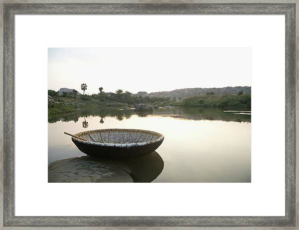 Coracle At The Bank Of A River Framed Print by Exotica.im