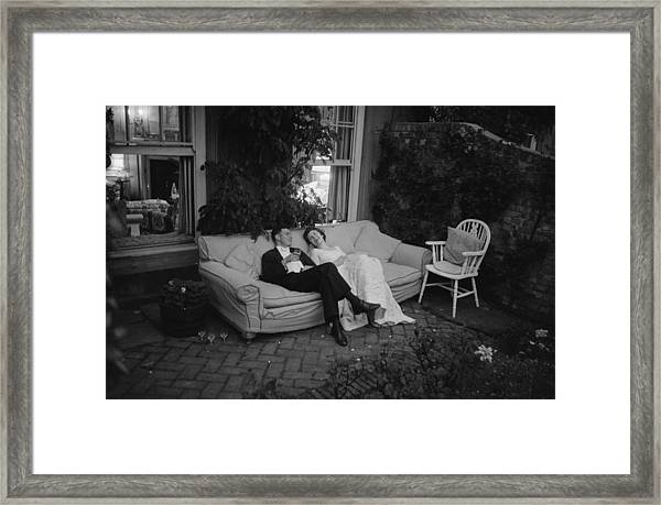 Couple At Party Framed Print