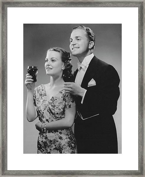 Couple Dressed Up Holding Drinks Framed Print