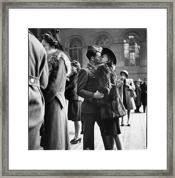 Couple In Penn Station Sharing Farewell Framed Print
