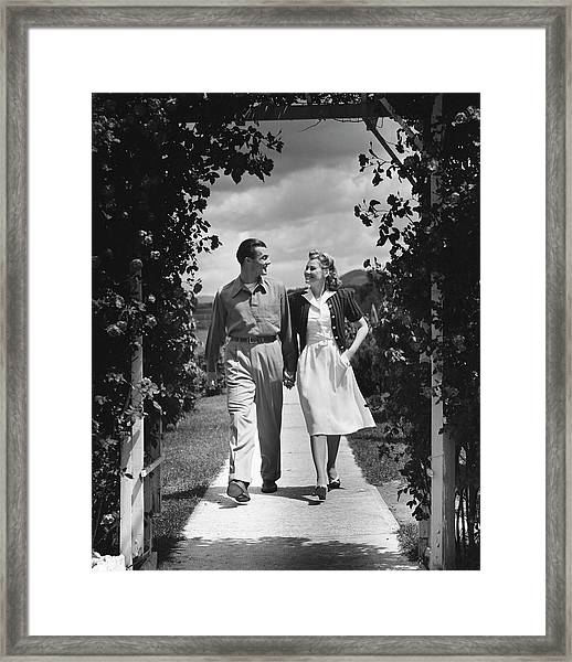 Couple Outdoors Holding Hands While Framed Print