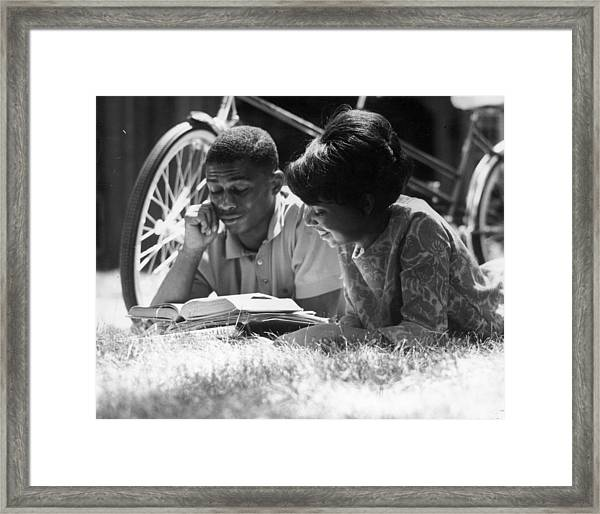 Couple Reading Framed Print by Hulton Collection