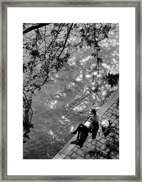 Couple Relaxing On Bank Of Seine Near No Framed Print