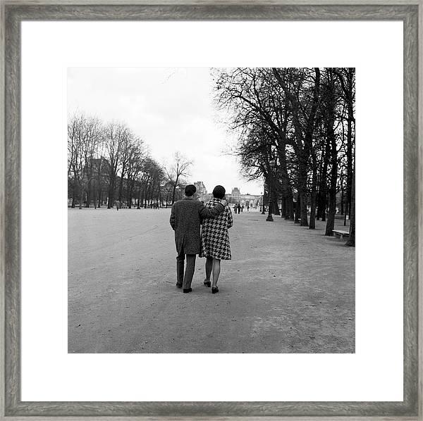 Couple Walking In The Tuilerie Gardens Framed Print