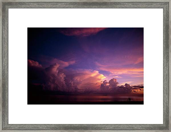 Couple Walking On Beach At Sunset Over Framed Print