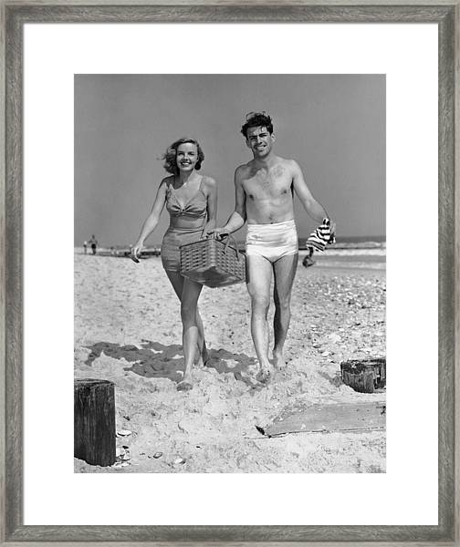 Couple Walking With Picnic Basket On Framed Print