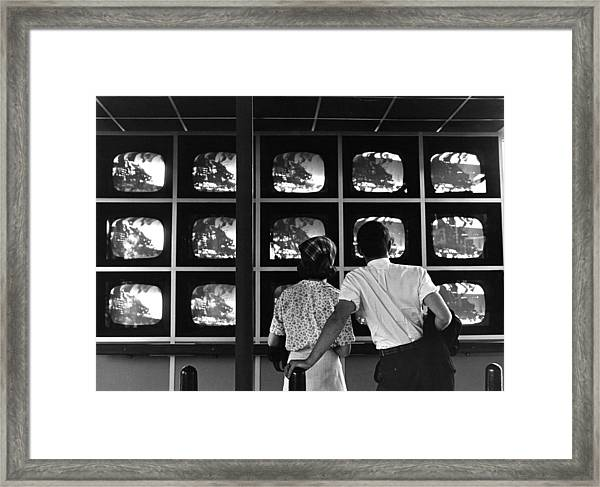 Couple Watching Televisions At New York Framed Print by Alfred Gescheidt