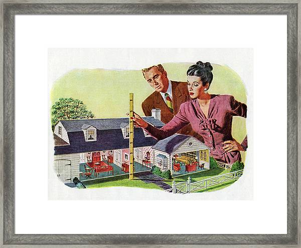 Couple With Model Of New Home Framed Print