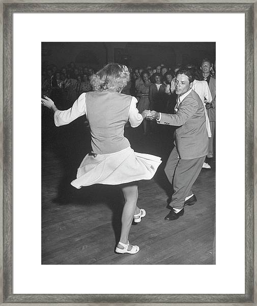 Couples Dancing In A Jitterbug Contest Framed Print