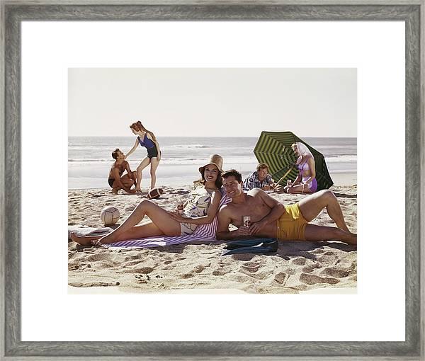 Couples Having Fun On Beach, Smiling Framed Print