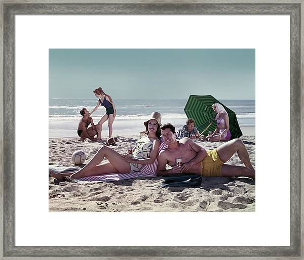 Couples On The Beach Framed Print by Tom Kelley Archive