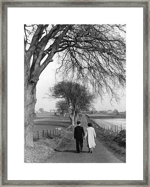 Courting Couple Framed Print