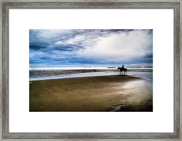 Cowboy Riding Horse On Beach Framed Print