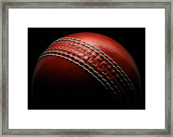 Cricket Ball On Black Background Framed Print by Ian Mckinnell