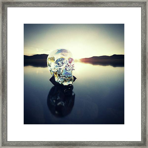 Crystal Skull Laying On Rock In Lake Framed Print by Doug Armand