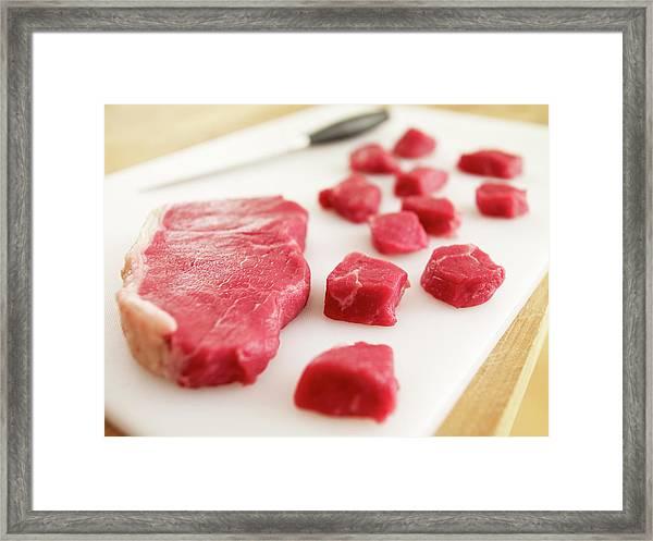 Cubed Raw Steak On Cutting Board Framed Print