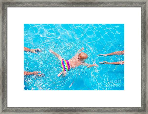 Cute Little Baby Swimming Underwater Framed Print
