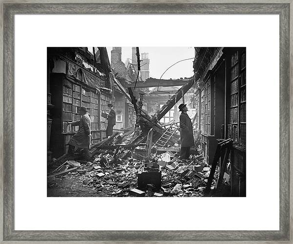 Damaged Library Framed Print by Central Press